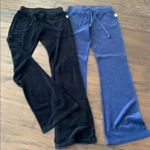 2 pairs of terry cloth flare sweat bottoms